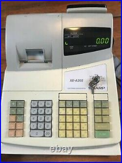 Sharp XE A202 cash register with spare cash tray 2 keys and box of 20 till rolls
